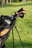 Golf. Bag standing in the middle of course Stock Images