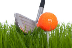 Golf. Club and a ball on a tee - isolated on a white backgorund Royalty Free Stock Photos