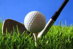 Golf. Golf ball on tee against blue sky Royalty Free Stock Photography