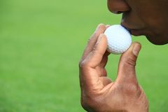 Golf 15. Image of a Golf ball falling  just short of it's goal and a kiss Royalty Free Stock Image