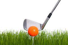 Golf. Isolated Golfball and Golfclub on a white backgorund with some green Stock Images