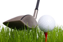 Golf. A Golfclub and a golfball - studio shot on a white background Royalty Free Stock Photos