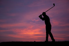 Golf. One male golfers at sunset Stock Photo