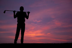 Golf. One male golfers at sunset Royalty Free Stock Images