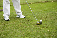 Golf. Player is ready to strike the ball Stock Photo