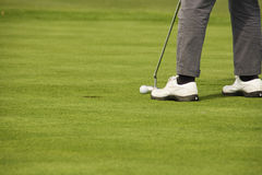 Golf. The feet of a golfer on the verge of throwing Stock Photos