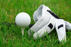 Golf. Detail of golf ball and gloves Royalty Free Stock Photography