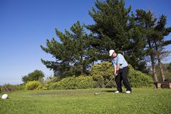 Golf #41. Man playing golf on the tee box Stock Image