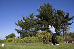 Golf #45. Man playing golf on the tee box Stock Photos
