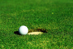 Golf. A golf ball is near the hole Stock Image