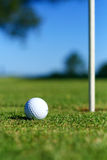 Golf. Ball on putting green, shallow focus on ball Royalty Free Stock Images