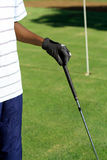 Golf. A hand with glove holding a golf club Royalty Free Stock Image