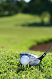 Golf. A golf club (driver) about to strike a golf ball on a tee stock photos