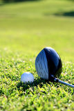 Golf. A set of golf ball and tee with a club Stock Photos
