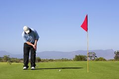 Golf #53. Man putting on the green Stock Photo