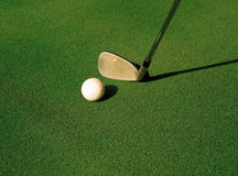 Golf. A golf club about to strike a golf ball on a tee Stock Images