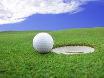Golf. Detail ball with hole on green royalty free stock images