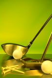 Golf. Ing equipment on a green background Royalty Free Stock Photos
