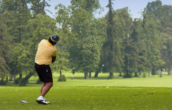 Golf. A man teeing off, playing golf Stock Photo