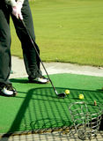 Golf. A golf club (driver) about to strike a golf ball on a tee Stock Images