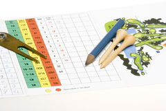 Golf accessories. And pencil on a golf scorecard Royalty Free Stock Image