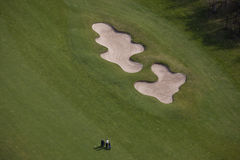 Golf aerial. Aerial view of a golf course and two golfers Royalty Free Stock Images