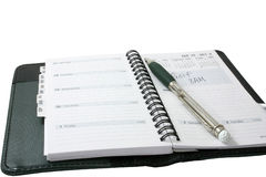Golf Appointment. Schedule book with golf appt. written in with a golf pen Stock Photos