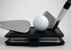 Golf appointment. Golf clubs and ball on filofax stock photography