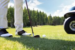 Golf approach shot with iron from fairway at sunny day.  stock photos