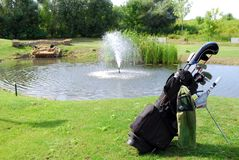 Golf bag. With clubs and water behind stock photos