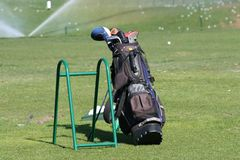 Golf Bag. Golf clubs set up at driving range Stock Images