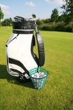 Golf bag. On green field stock photo