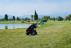Golf bag on a course. Golf bag with clubs in the middle of a nice course Royalty Free Stock Photos
