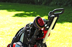 Golf bag on court. Golf bag on the green court closeup as a horizontal image Royalty Free Stock Photography