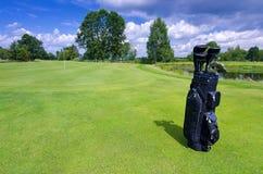 Golf bag on a green field Stock Photos
