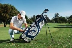 Golf bag man Stock Images