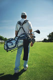 Golf bag man. Golf man walking with shoulder bag on course in fairway stock photography