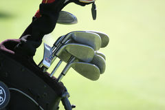 Golf bag and set of clubs. On green Royalty Free Stock Photos
