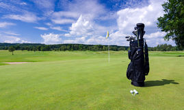 Golf bag on a Swedish golf field. Golf composition with golf bag on a green field stock image