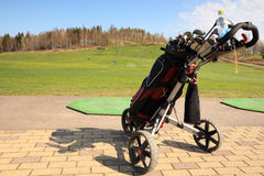 Golf bag and trolley on  driving ranch Royalty Free Stock Photos