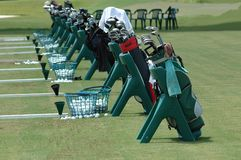 Golf Bags. Photographed golf bags lined up at a local golf school in Florida Royalty Free Stock Images