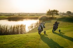 golf bags on green Royalty Free Stock Photos