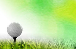 Golf ball. A design background with golf ball on tee Royalty Free Stock Image