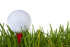 Golf Ball. On red tee in grass, over white background Royalty Free Stock Image