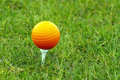 Golf Ball. Beautiful golf ball in grass with great colors Royalty Free Stock Photography