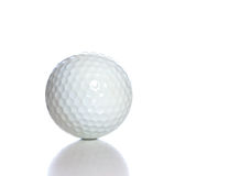 Golf Ball. A white golf ball with a reflection, shot against a white background Royalty Free Stock Photo