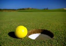 Golf ball. Yellow golf ball on a golf course Stock Photos