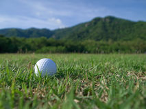 Golf ball. Would cross the mountain to be Royalty Free Stock Photo