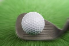 Golf ball. A golf ball hit from a mid iron on practice tee Royalty Free Stock Photo