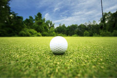 Golf Ball. Mooresville, NC- Golf ball sits on the green waiting to be hit royalty free stock photography